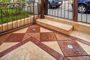 Stamped concrete patios are highly customizable, affordable, and visually appealing.