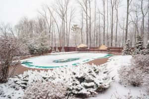 Clean and cover your swimming pool before the winter weather arrives