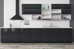 A black and white kitchen with several open cabinet shelves